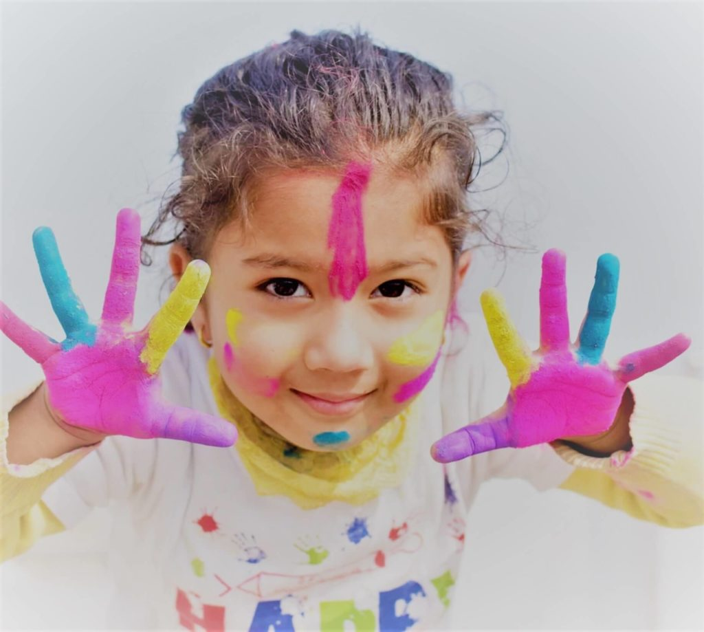 sydney nepalese child using misight or orthokeratology with paint all over hands