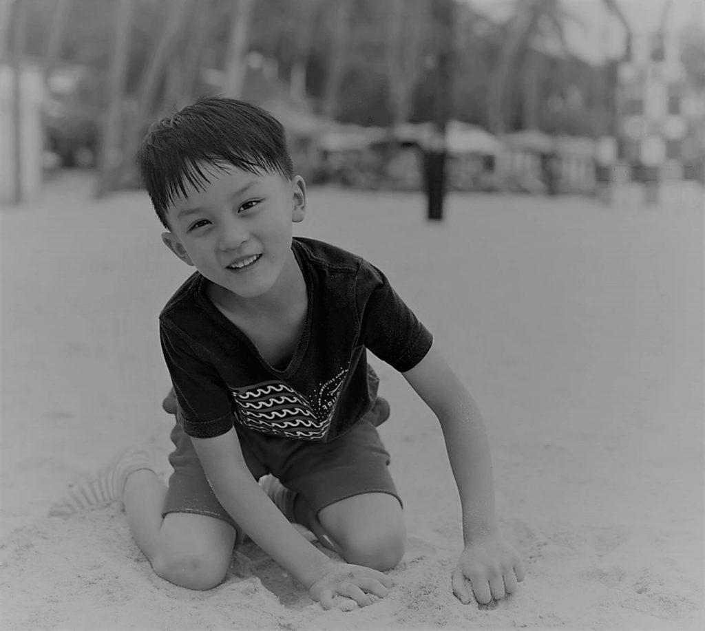 happy child using orthokeratology in black and white