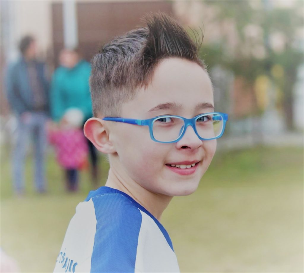 sydney young boy in extended focus multifocal glasses for myopia control blue frame alternative to orthokeratology